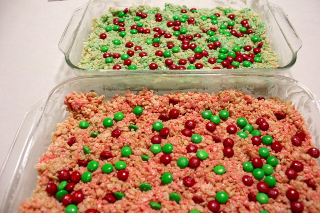 following the standard rice krispie treat recipe we add the food coloring to the melted marshmallows and top the treats before they set with the red